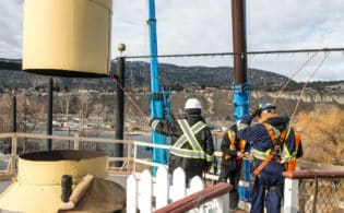 manufacturing and engineering workers on site of ss sicamous stack crane removal
